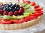 Fruit tart filled with marscapone cream and topped with seasonal fruit.