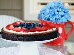 Chocolate almond torte with a marscapone frosting and fresh fruit.